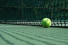 Tennis ball near net Stock Photography