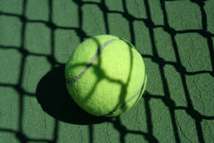 Tennis ball near net Stock Photos