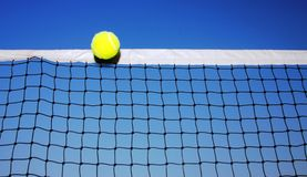 Tennis ball and net Royalty Free Stock Photography