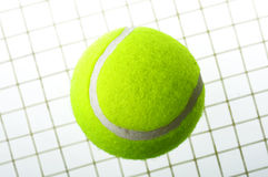 A tennis ball on net Royalty Free Stock Photo