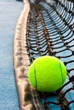 Tennis ball and net Royalty Free Stock Photo