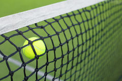Tennis ball in the net Royalty Free Stock Photos