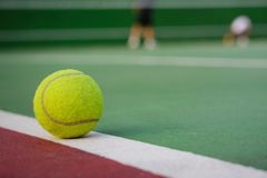 Tennis ball on net background. Tennis ball on blur net and court background Stock Photo