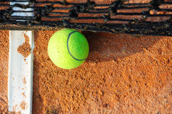 Tennis ball and net Royalty Free Stock Image