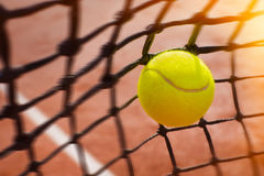 Tennis ball in net Royalty Free Stock Photos
