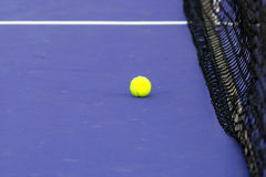 Tennis ball & net on court field Royalty Free Stock Photography