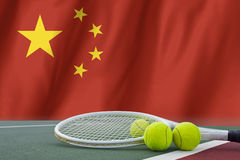 Tennis ball in net on flag China Royalty Free Stock Photo