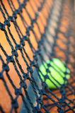 Tennis ball and net (Focus on net) Stock Photos