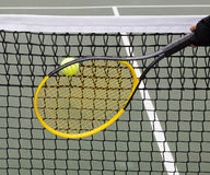 Tennis Ball into Net during game Stock Images