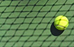 Tennis ball with net shadow Royalty Free Stock Image