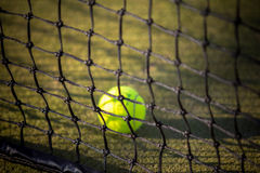 Tennis ball on the net Royalty Free Stock Photos