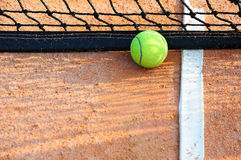Tennis ball on a tennis clay court Royalty Free Stock Image