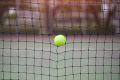 Tennis ball in net at tennis court Stock Photography