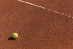 Tennis ball next to line Royalty Free Stock Photography