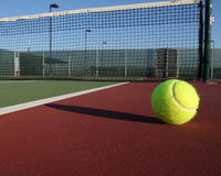 Tennis ball off the court Royalty Free Stock Photos