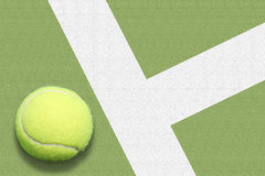 Tennis ball out. On court green Royalty Free Stock Images