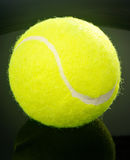 Tennis ball over black background Royalty Free Stock Images