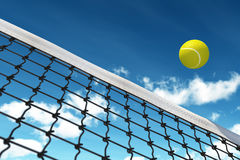 Tennis Ball over Net. With background sky Royalty Free Stock Images