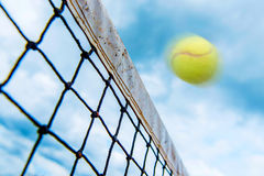 Tennis ball over the net Royalty Free Stock Image
