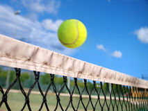 Tennis ball over the net Stock Image