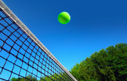 Tennis ball over net Royalty Free Stock Photography