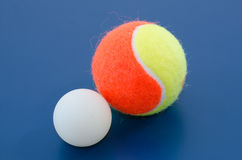 tennis ball and  ping pong ball Royalty Free Stock Images
