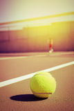 Tennis ball and player with copy space Stock Image