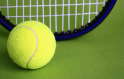 Tennis ball and racke. T green background Royalty Free Stock Photos