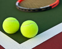 Tennis ball and racket. On a tennis court Stock Photo