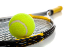 Tennis ball and racket. A colorful tennis ball and racket on a white background with copy space Royalty Free Stock Photography