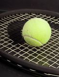 Tennis Ball on Racket Stock Photography