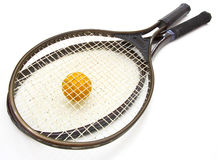 A tennis ball and racket Royalty Free Stock Photography