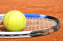 Tennis ball and racket. On the court Stock Images