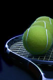 Tennis ball in the racket royalty free stock image