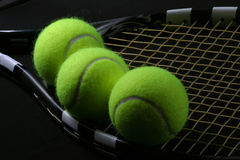 Tennis ball in the racket Stock Photography