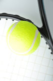 A tennis ball on racket Royalty Free Stock Image