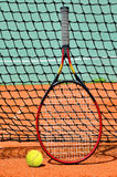 Tennis ball and racket. On the court Stock Photo
