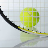 Tennis ball and racket. Against a white background Royalty Free Stock Images
