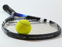 Tennis ball on a racket. This is a tennis ball on a racket with a white background Royalty Free Stock Image