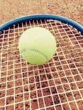 Tennis ball on racket Stock Photos