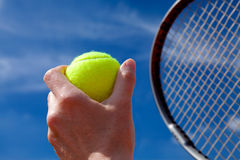 Tennis ball and racket. Tennis ball and blue sky Royalty Free Stock Photos