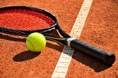 Tennis ball and racket is on the carpet court Royalty Free Stock Images