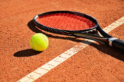 Tennis ball and racket is on the carpet court horizontal Royalty Free Stock Photography