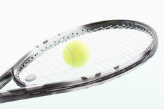 Tennis ball on racket, close-up Royalty Free Stock Image