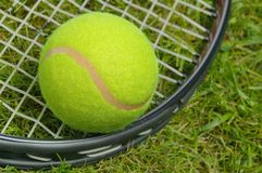 Tennis ball and racket close up Royalty Free Stock Photos