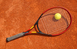 Tennis ball and racket. On the court Stock Photos