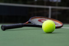 Tennis Ball and racket. On the court Royalty Free Stock Photo