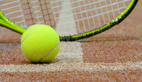 Tennis ball and racket on the court with copy space. Stock Image