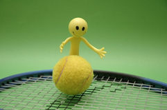 Tennis ball, racket and figure Royalty Free Stock Photos