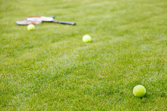 Tennis ball and racket on  grass Stock Photo